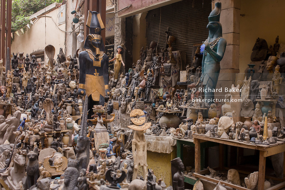 Tourist trinkets and statues in the souk at Luxor, Nile Valley, Egypt.
