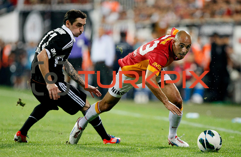 Besiktas's Roberto Hilbert (L) and Galatasaray's Nordin Amrabat during their Turkish Superleague soccer derby match Besiktas between Galatasaray at the Inonu Stadium at Dolmabahce in Istanbul Turkey on Thursday, 26 August 2012. Photo by TURKPIX
