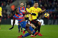 Timothy Fosu-Mensah of Crystal Palace (L) challenges Richarlison of Watford (R). Premier League match, Crystal Palace v Watford at Selhurst Park in London on Tuesday 12th December 2017. pic by Steffan Bowen, Andrew Orchard sports photography.