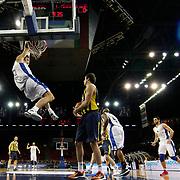 Anadolu Efes's Kerem Gonlum (2ndL) during their Turkish BEKO Basketball League derby match Anadolu Efes between Fenerbahce at Abdi ipekci Arena in Istanbul, Turkey, Monday, February 03, 2014. Photo by Aykut AKICI/TURKPIX