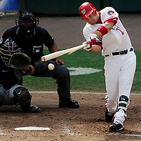 21 July 2007:  Washington Nationals third baseman Ryan Zimmerman (11) breaks his bat and grounds out to third base in the 4th inning against Colorado Rockies pitcher Rodrigo Lopez as catcher Yorvit Torrealba (8) watches along with home plate umpire Adrian Johnson.  The Nationals defeated the Rockies 3-0 at RFK Stadium in Washington, D.C.  ****For Editorial Use Only****