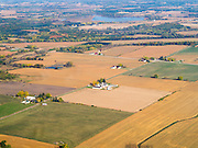 Aerial view of Columbia County, Wisconsin, with stream and wetlands in the foreground.