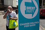 Pro Brexit Party protester blows his nose in Westminster as inside Parliament the Tory leadership race continues on 17th June 2019 in London, England, United Kingdom.