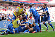 Glossop players celebrate the opening goal during the FA Vase Final between Glossop North End and North Shields at Wembley Stadium, London, England on 9 May 2015. Photo by Phil Duncan.