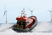 Caister lifeboat and wind turbines of the Caister Wind Farm, Norfolk, United Kingdom.