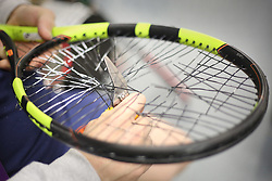 Old strings being cut out a racket in the Stringing Room on day two of the Wimbledon Championships at the All England Lawn Tennis and Croquet Club, Wimbledon. PRESS ASSOCIATION Photo. Picture date: Tuesday July 4, 2017. See PA story TENNIS Wimbledon. Photo credit should read: Philip Toscano/PA Wire. RESTRICTIONS: Editorial use only. No commercial use without prior written consent of the AELTC. Still image use only - no moving images to emulate broadcast. No superimposing or removal of sponsor/ad logos.