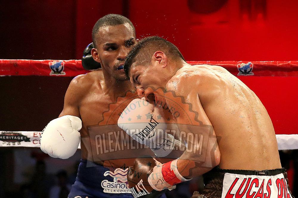 Jonathan Gonzalez (L) lands a shot the head of Richard Rodriguez during a Telemundo boxing match between at Osceola Heritage Park on Friday, February 23, 2018 in Kissimmee, Florida.  (Alex Menendez via AP)