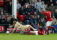 Photo: Dave Linney.<br />Walsall v Bristol City. Coca Cola League 1. 08/04/2006.<br />Bristol's Dave Cotterill is sent flying by Walsall's Ian Roper<br />to earn a penalty