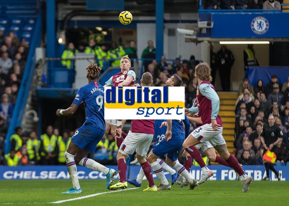 Football - 2019 / 2020 Premier League - Chelsea vs. Burnley<br /> <br /> James Tarkowski (Burnley FC) rises to head the ball back across the box as Burnley attack at Stamford Bridge <br /> <br /> COLORSPORT/DANIEL BEARHAM