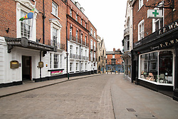 © Licensed to London News Pictures. 17/03/2020. Lincoln, Lincolnshire, UK. Deserted Lincoln. Pictured, An empty Bailgate area, usually a busy part of the City. The streets leading from the top of the City (Bailgate) down to the railway station at the bottom of the City are usually filled with commuters on their way to work unlike this morning as the streets were eerily quiet. Photo credit: Dave Warren / LNP