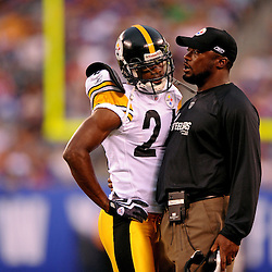 21 Aug, 2010: Pittsburgh Steelers head coach Mike Tomlin talks to cornerback Ike Taylor (24) after Taylor was ejected from the game for fighting during first half NFL preseason action between the New York Giants and Pittsburgh Steelers at New Meadowlands Stadium in East Rutherford, New Jersey.
