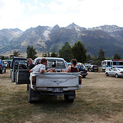 Locals drink beer in a Ute during the 50th Anniversary Glenorchy Race meeting. The races, which originally started in the 1920's, were resurrected in 1962 and have been run by local farmers and the rugby club on the first Saturday after New Years Day ever since. Glenorchy, Otago, New Zealand. 7th January 2012