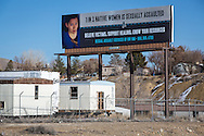 """Billboard serving as a public servuce announcemnet near the The San Juan Generating Plant just outside of Farmington, New Mexico in the Four Corners region, deemed an 'energy Sacrifice Zone,"""" by the Nixon administration, is one of America's largest coal plants."""