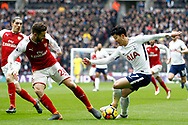 Son Heung-min of Tottenham Hotspur (R) in action with Shkordran Mustafi of Arsenal (L). Premier league match, Tottenham Hotspur v Arsenal at Wembley Stadium in London on Saturday 10th February 2018.<br /> pic by Steffan Bowen, Andrew Orchard sports photography.