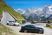 BMW M6 (white), Mercedes C63 AMG (black) Cars on The Stelvio Pass, Passo dello Stelvio, on route to Trafio in the Alps, Italy