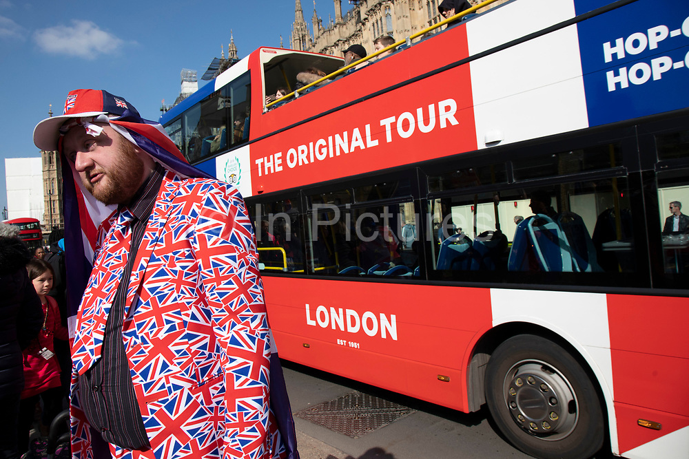 Royal superfan wearing a Union Jack suit chats with anti-Brexit protesters opposite Parliament in Westminster on the day the EU agreed an extension to Article 50 until the end of October, on 11th April 2019 in London, England, United Kingdom. With just two days until the UK is supposed to be leaving the European Union, the delay decision awaits. (photo by Mike Kemp/In Pictures via Getty Images)