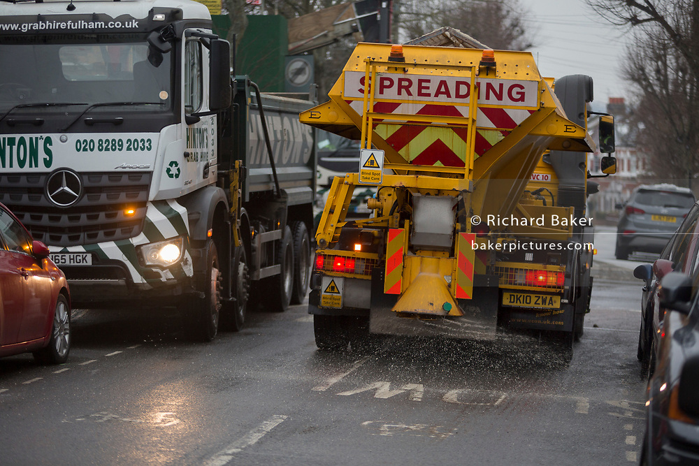 A Lambeth council gritting lorry spreads grit over a minor residential road in south London during the bad weather covering every part of the UK and known as the 'Beast from the East' because Siberian winds and very low temperatures have blown across western Europe from Russia, on 1st March 2018, in Lambeth, London, England.