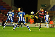QPR's Charlie Austin ® looks to set up an attack. Skybet championship match, Wigan Athletic  v Queens Park Rangers at the DW Stadium in Wigan, Lancs on Wed 30th Oct 2013. pic by Andrew Orchard, Andrew Orchard sports photography,