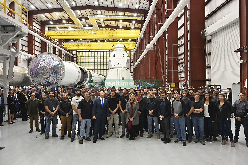 December 18, 2018 - Cape Canaveral, Florida, United States of America - U.S Vice President Mike Pence poses with NASA and SpaceX mission teams during a visit to the SpaceX NASA Dragon commercial crew capsule Demo-1 in the SpaceX hangar at the Kennedy Space Center December 18, 2018 in Cape Canaveral, Florida. Pence was in Cape Canaveral for the launch of a SpaceX Falcon 9 rocket carrying the GPS III SV01 Mission which was scrubbed at the last minute due to a glitch. (Credit Image: © Spacex via ZUMA Wire)