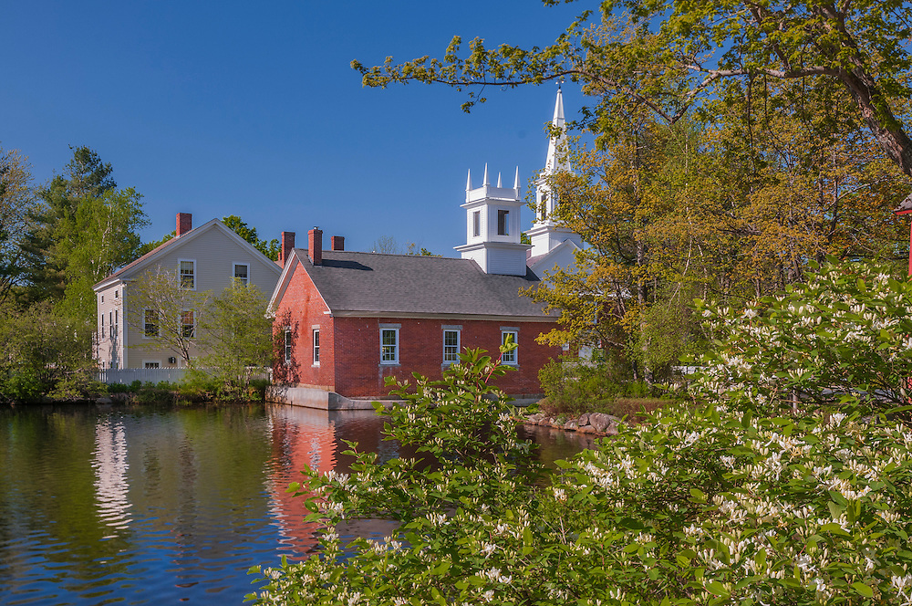 Harrisville Public Library and church steeple, with reflections in pond, Harrisville, NH