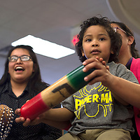 020715      Cayla Nimmo<br /> <br /> Aiden Burbank plays with a rain stick during Camilla Dodsen's interactive performance at the Octavia Fellin Public Library Children's branch Saturday afternoon.