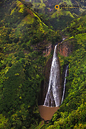 Lush Inland waterfalls during helicopter tour in Kauai, Hawaii, USA
