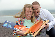 """REPRO FREE PHOTO:   <br /> Clodagh and dad Liam Quinlan from Renard with some freshly smoked salmon from the same oven her grandfather used 50 years ago at his smokery in Renard, Cahersiveen, County Kerry on Thursday as the family business celebrate winning two gold medals at the 2015 Great Taste Awards for their smoked salmon. Quinlan's Kerryfish are the only Salmon Smoker in Ireland and the UK to Scoop 3 stars in the awards and it's the second year in a row for Quinlan's Organic Smoked Irish Salmon to win a Great Taste Award.<br /> Photo: Don MacMonagle<br /> <br /> PRESS RELEASE<br /> Quinlan's Kerryfish is celebrating again after winning   two prestigious 3 star Great Taste Awards in the 2015 competition and being placed twice in the top 50 foods in the UK and Ireland.  Quinlan's Kerryfish are the only Salmon Smoker in Ireland and the UK to Scoop 3 stars in the awards and it's the second year in a row for Quinlan's Organic Smoked Irish Salmon to win a Great Taste Award.<br />Quinlan's Organic Smoked Irish Salmon and  Quinlan's Organic Smoked Irish Salmon with Atlantic Sea Salt  were each awarded the prestigious three-star Gold Great Taste Awards and Top 50 Status. In addition both of Quinlan's Organic Smoked Irish Salmon were served at the 3-star judging dinner and received tremendous compliments from the Judges.<br />Considering that there were over 10,000 entries, and that only 130 products were awarded a 3* Gold Medal, this is a huge endorsement for Quinlan's.<br />Judged by over 400 of the most demanding palates belonging to food critics, chefs, cooks, restaurateurs, producers and a host of food writers and journalists, including Masterchef judge and restaurant critic Charles Campion, Great Taste is the most respected food accreditation scheme for artisan and speciality food producers.  <br />The comments from the judges for Quinlan's Organic Smoked Irish Salmon with Atlantic Sea Salt cure included:<br />""""A taste of the coastline, rock pools and sea weed"""", t"""