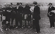 """Michael Collins chatting to some of the Kilkenny team prior to the Leinster final in September 1921. It was one of his first public appearances since the Truce had been called in July. """"Your are not only upholding the great game"""", the told them, """" but you are also upholding one of the most ancient and cherished traditions of Ireland."""""""