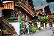 Tourists visit Brunngasse cobbled street with 18th Century architecture, at Brienz in the Bernese Oberland, Switzerland
