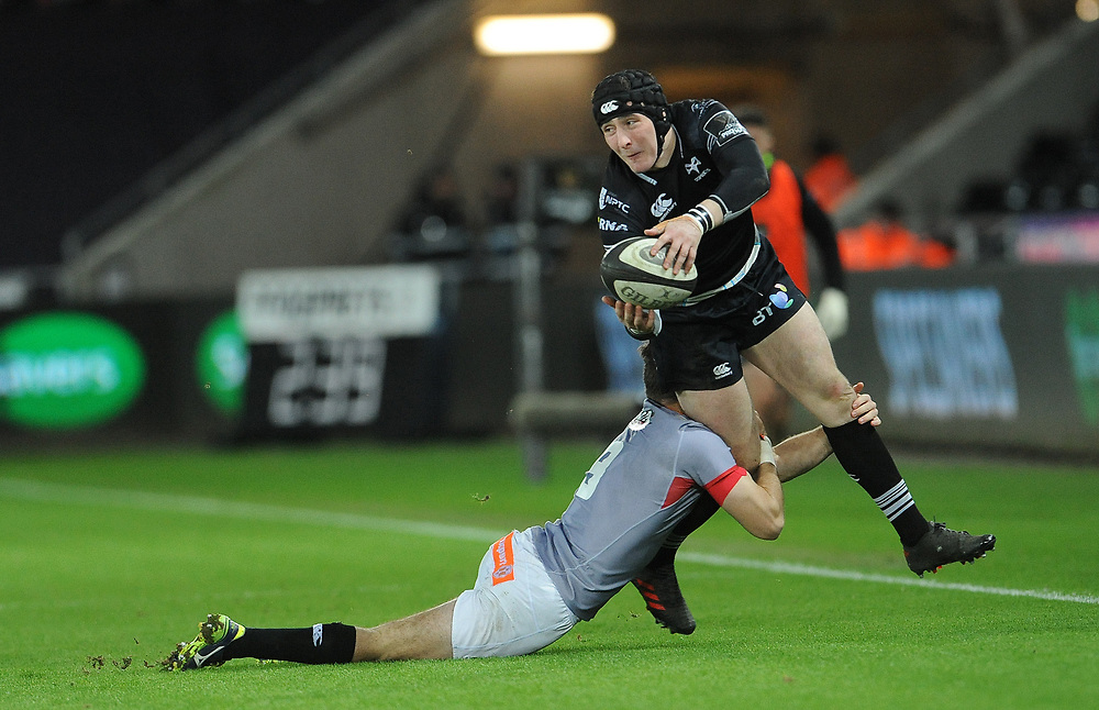 Ospreys' Sam Davies is tackled by Southern Kings Rowan Gouws<br /> <br /> Photographer Ian Cook/CameraSport<br /> <br /> Guinness Pro14 Round 15 - Ospreys v Southern Kings - Friday 16th February 2018 - Liberty Stadium - Swansea<br /> <br /> World Copyright © 2018 CameraSport. All rights reserved. 43 Linden Ave. Countesthorpe. Leicester. England. LE8 5PG - Tel: +44 (0) 116 277 4147 - admin@camerasport.com - www.camerasport.com