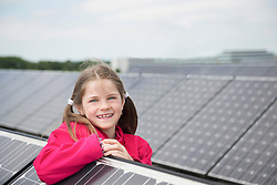 Portrait young girl smiling solar cell park