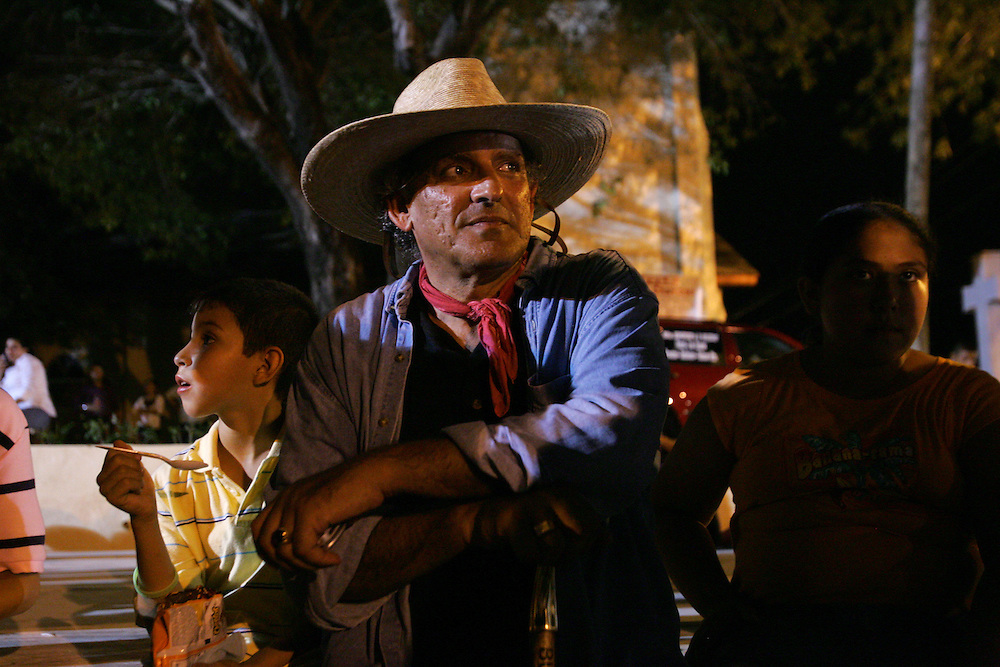 After a long day of walking, Jay Johnson Castro stops for the night in Roma during the town's annual festival.