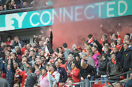 Liverpool fans celebrate after Philippe Coutinho of Liverpool scores the first goal for the side to make it 1-0. The FA Cup, semi final match, Aston Villa v Liverpool at Wembley Stadium in London on Sunday 19th April 2015.<br /> pic by John Patrick Fletcher, Andrew Orchard sports photography.