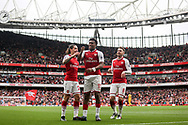 Alex Iwobi Of Arsenal © celebrates after he scores his teams 2nd goal  with Hector Bellerin (l) and Aaron Ramsey ® of Arsenal.<br /> Premier league match, Arsenal v Brighton & Hove Albion at the Emirates Stadium in London on Sunday 1st October 2017. pic by Kieran Clarke, Andrew Orchard sports photography.