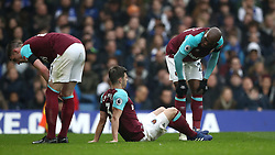 West Ham United's Angelo Ogbonna (right) checks on team-mate Aaron Cresswell (centre) after he picks up an injury