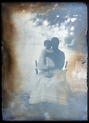 extreme fading portrait of mother with a toddler on a glass plate France ca 1910s