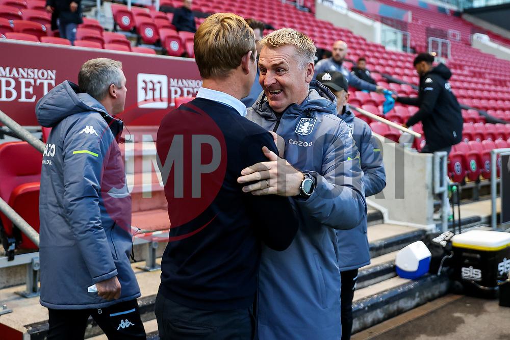 Bristol City head coach Dean Holden greets Aston Villa manager Dean Smith - Rogan/JMP - 24/09/2020 - Ashton Gate Stadium - Bristol, England - Bristol City v Aston Villa - Carabao Cup Third Round.