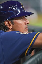 March 26, 2018 - Houston, TX, U.S. - HOUSTON, TX - MARCH 26: Milwaukee Brewers first base coach Carlos Subero watches from the dugout during the game between the Milwaukee Brewers and Houston Astros at Minute Maid Park on March 26, 2018 in Houston, Texas. (Photo by Ken Murray/Icon Sportswire) (Credit Image: © Ken Murray/Icon SMI via ZUMA Press)