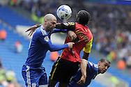 Cardiff City's Matthew Connolly (l) and Lee Peltier (r) challenge Birmingham's Clayton Donaldson (c) for a header. Skybet football league championship match, Cardiff city v Birmingham city at the Cardiff city stadium in Cardiff, South Wales on Saturday 7th May 2016.<br /> pic by Carl Robertson, Andrew Orchard sports photography.