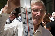 "London, UK. Thursday 5th September 2013. Man with a thermometer shows the temperature exceeding 50 degrees C, beyond the limit of his guage. Urgent action in planned to ""cover up"" the Walkie Talkie skyscraper in the City after sunlight reflected from the building melted a car on the streets below. Temperatures have been measured in excess of 50 degrees C, and as much as 70 degrees at it's peak. The 525ft building has been renamed the ""Walkie Scorchie"" after its distinctive concave surfaces reflected a dazzling beam of light which has caused extensive damage to nearby buildings."