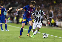 September 12, 2017 - Barcelona, Spain - Sergi Roberto and Douglas Costa during the match between FC Barcelona - Juventus, for the group stage, round 1 of the Champions League, held at Camp Nou Stadium on 12th September 2017 in Barcelona, Spain. (Credit Image: © Urbanandsport/NurPhoto via ZUMA Press)