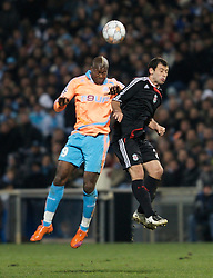 MARSEILLE, FRANCE - Tuesday, December 11, 2007: Liverpool's Javier Mascherano and Olympique de Marseille's Djibril Cisse during the final UEFA Champions League Group A match at the Stade Velodrome. (Photo by David Rawcliffe/Propaganda)