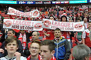 Fleetwood Town fans celebrate as they hold 'League 1 Here we come' banners.  Skybet football league two play off final match , Burton Albion v Fleetwood Town at Wembley Stadium in  London on Monday 26th May 2014.<br /> pic by John Patrick Fletcher, Andrew Orchard sports photography.