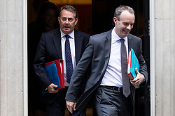 © Licensed to London News Pictures. 16/10/2018. London, UK. Secretary of State for Exiting the European Union Dominic Raab (R) and Secretary of State for International Trade Liam Fox (L) leave 10 Downing Street after the Cabinet meeting. Photo credit: Rob Pinney/LNP