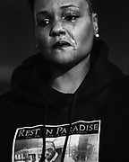 Che Taylor's step-daughter Demeka Green reacts to a description of her father during a press conference responding to Sunday's fatal shooting of Taylor by the Seattle Police Department, Tuesday, Feb. 23, 2016.