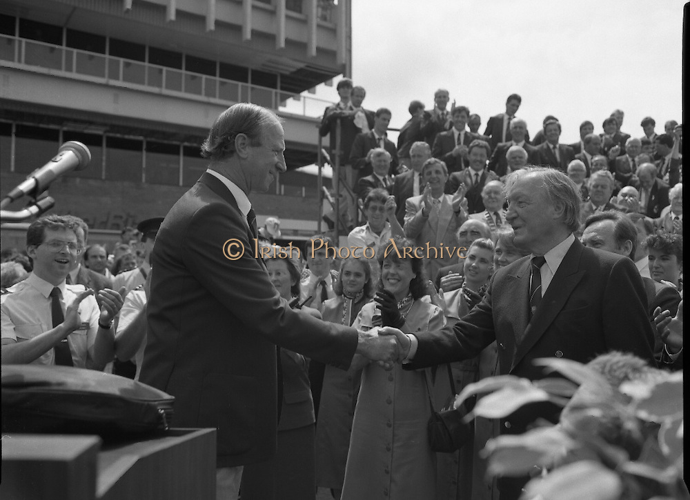 Irish Soccer Team Welcomed Home.   (R81)..1988..19.06.1988..06.19.1988..19th June 1988..After their great success in Germany in Euro 88, the Irish soccer team had a triumphant homecoming. An Taoiseach, Charles Haughey TD and his government were to the forefront of the welcome. Thousands of fans thronged the airport and all the approach roads in the hope of seeing the team. The full squad is as follows..1.GK.Packie Bonner. Celtic.2.DF.Chris Morris. Celtic.3.DF.Chris Hughton  Tottenham Hotspur.4.DF.Mick McCarthy. Celtic.5.DF.Kevin Moran. Manchester United.6.MF.Ronnie Whelan. Liverpool.7.MF.Paul McGrath. Manchester United.8.MF.Ray Houghton. Liverpool.9.FW.John Aldridge. Liverpool.10.FW.Frank Stapleton Derby County.11.MF.Tony Galvin. Sheffield Wednesday.12.FW.Tony Cascarino. Millwall.13.MF.Liam O'Brien. Manchester United.14.FW.David Kelly. Walsall.15.MF.Kevin Sheedy. Everton.16.GK.Gerry Peyton. Bournemouth.17.FW.John Byrne. Le Havre.18.FW.John Sheridan. Leeds United.19.DF.John Anderson. Newcastle United.20.FW.Niall Quinn. Arsenal..Image shows the  An Taoiseach,Charles Haughey TD, congratulating Jack Charlton on the exploits of the Irish Soccer Team during Euro 88.