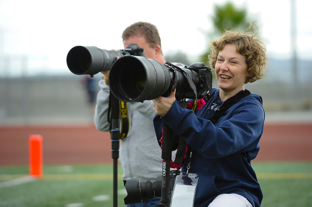 11/16/13 --- SPORTS SHOOTER ACADEMY-MINI --- YORBA LINDA, CA: Rick Man and Lara Gale cover the Santa Ana College - Fullerton College football game during the SSA-Mini. Photo by Christy Radecic, Sports Shooter Academy