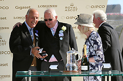 Trainer David Elsworth is presented with his trophy after winning the Duke of Edinburgh Stakes with Dash of Spice during day four of Royal Ascot at Ascot Racecourse