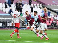 Football - 2020 / 2021 Premier League - Final Round - West ham United vs Southampton - London Stadium<br /> <br /> West Ham United's Pablo Fornals celebrates scoring the opening goal with Jarrod Bowen.<br /> <br /> COLORSPORT/ASHLEY WESTERN