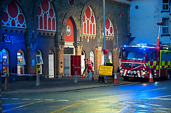 © Licensed to London News Pictures. 26/10/2019. Builth Wells, Powys, Wales, UK. Fire services pump out water from The Wyeside Arts Centre following very heavy rainfall for several days, resulting in extremely high river levels of the River Wye and River Irfon, which flood parts of the Welsh market town of Builth Wells in Powys, UK. causing damage to property. Photo credit: Graham M. Lawrence/LNP